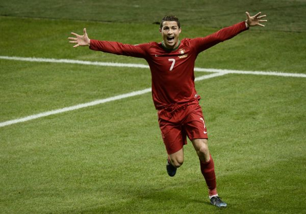 Portugal's Cristiano Ronaldo celebrates after scoring the 2-3 goal during the World Cup 2014 qualifying playoff second leg soccer match between Sweden and Portugal at Friends Arena in Stockholm, Tuesday, Nov. 19, 2013. (AP/TT/Pontus Lundahl) SWEDEN OUT